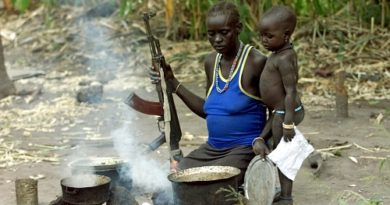 South Sudan woman cooking